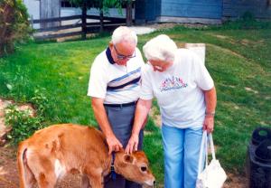 600-Sugarbush-Cheese-&-Maple-Farm-older-couple-and-calf